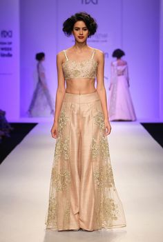Payal Singhal presented her Autumn-Winter 2015 collection 'A French Love Song'. The Neo-Indian collection  is inspired from the the delicate femininity of Chantilly lace and the effortless grace of the gamine Parisian.