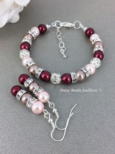 Material - 8mm burgundy, pink and taupe glass pearls, 8mm rhinestones bead, and 8mm hinestones spacers. Silver-plated clasp, ear wires, and extender. Size - Bracelet ~ please choose from the drop down menu Earrings ~ 1-1/4 inches Matching Strand Necklace Jewlery Set -