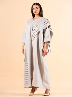 Grey linen abaya with a modern pattern is a good addition to your modest wear wardrobe.