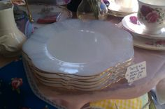 Set of six blue, gold edged opaque plates £18