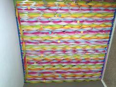 Streamers wall decoration. Fantastic way to cover up a 90's mirrored wall.