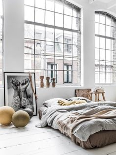 dreamy bedroom loft warehouse, neutrals, duvet layers, art and light - via fashionsquad.com