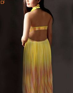 """""""If you have it flaunt it"""" Flaunt your toned back this summer with this canary yellow dress. This dress material has undergone with the tie and dye technique. #CanaryYellow #BackLess #TieAndDye To buy this sizzling dress, visit us on http://droomfashion.com/"""