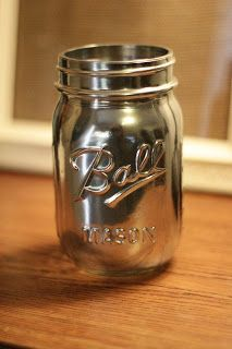 "Mason jar painted with Krylon's ""Looking Glass"" spray paint for a reflective finish!"