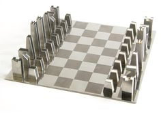 Mid-century stainless steel and nickel chess set.
