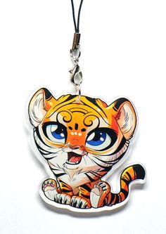 That Tiger charm is the perfect gift for all animal lovers, especially Tiger lovers. Will you resist to his little cute face ? Product details : Size of the impression : 2 Size of the strap : 7 cm This Tiger charm is tough, has a great finition, and will be perfect on your bags, mobile