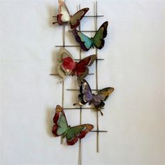 Add a statement to your wall with our beautiful butterfly metal wall art. This metal wall art features five butterflies in fabulous reds, greens, purples and naturals set on a metal grid. Metal Butterfly Wall Art, Metal Wall Art, Harry Corry, Metal Grid, Beautiful Butterflies, Plant Hanger, Bloom, Decorating, Purple