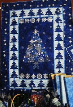 Christmas Night lighted quilt seen at The Quiltmakers Shoppe. Christmas Patchwork, Christmas Sewing, Blue Christmas, Christmas Projects, Christmas Night, Christmas Trees, Christmas Quilting, Christmas Villages, Patchwork Natal