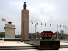 The Eternal Flame of African Liberation, lit by Kwame Nkrumah, stands on Independence Square in Accra, Ghana. The Black Star Gate is in the background. Capital Of Ghana, Eternal Flame, Accra, Stargate, Black Star, West Africa, Cn Tower, African, Travel