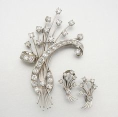 14K WHITE GOLD & DIAMOND BROOCH AND EARCLIPS 47 diamonds approx 6.65 cts.