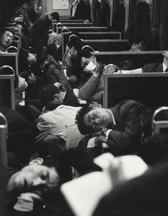 People sleeping on a night train in Japan, 1964. Photo by Nicolas Bouvier.