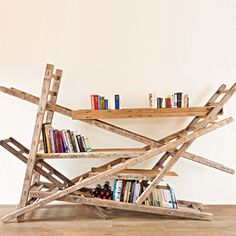 Dutch artist Chris Ruhe designs and builds furniture using reclaimed building materials set at radical angles. Whether its a cabinet unit made from old doors, or shelves made from discarded ladders, Ruhe's divergent style comes out in his work. Ladder Bookshelf, Bookshelf Design, Bookshelf Storage, Reclaimed Building Materials, Creative Bookshelves, Custom Bookshelves, Bookcases, Bookshelf Inspiration, Old Ladder