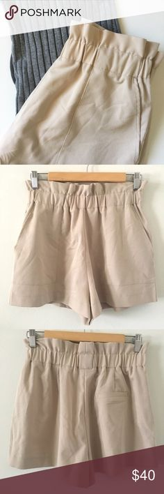 LF / high-waisted shorts + LF - faith in love brand + high waisted shorts + nude color + 2 pockets + elastic waist band with ruffle accent + never worth + length • front: 14in + size 10 - fits like a medium   _brand new, never worn high waisted shorts. purchased from LF, brand is faith in love. great on-the-go shorts that would pair perfect with flats. LF Shorts