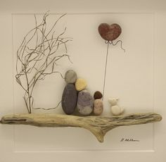 Pebble art picture of family of three and dog by PebbleartShop