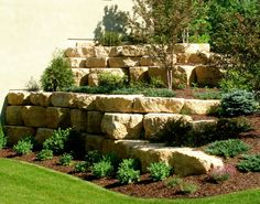 At Boulder Images we design boulder retaining walls that fit into the natural la. - At Boulder Images we design boulder retaining walls that fit into the natural landscape of your bac -