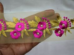 Magenta and Gold Embroidered designer Trims Fashion trim tape   You can purchase from below link or What's App no. is +91-9999684477. We also take wholesale inquiries.  http://shopofembellishments.com/tri2232-magenta-decorative-fabric-trim-by-the-yard