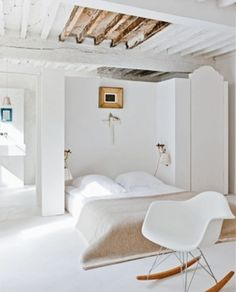 A white bedroom in a Period home that takes inspiration from the now . . . leaving a little of the then on show in contrast.