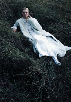 by Jasper Abels | grassy | fashion in the forest | nature | woods | high fashion | fashion editorial | white gown | haute couture | relax | pose | rest