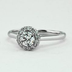 18K White Gold Halo Diamond Ring, set with beyond conflict free 0.41ct. round diamond.