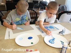 Make some ocean paintings with foil fish!