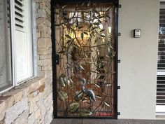 This sculptured door makes a statement to this home in Dunsborough Western Australia.  It features a heron among the foliage, with a blue wren sitting on a branch of a gumtree.  The backdrop is the textured bark of a peppermint gum, that is featured around the front of the garden.  Jalmer specialise in doors that are secure with high quality deadlocks, concealed fixings, steel framing and full welded design.
