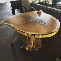 """Just finished this awesome table for a local restaurant #Margauxs in #Raleigh #nc Top slab is 3"""" thick red oak and the bottom is a gnarly Cedar stump. Custom inlay with volcanic sand and crushed tumbled glass inlay. #ilovemyjob #woodwork #slab #table #homedecor #wood #design #designer #workhard #playharder #unrefineddesigns #trees #nature de unrefineddesigns"""