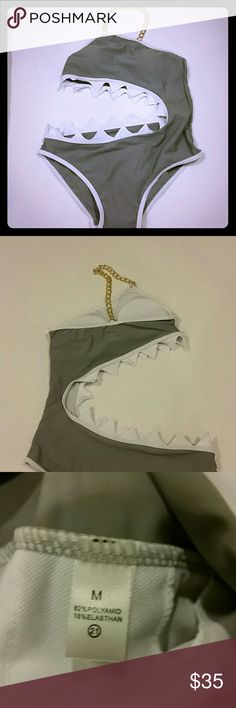 SHARK BITE swimsuit NWOT Women's Shark Bite swimsuit NWOT Conversation piece and adorable!!!!!????? Bought here from a boutique, but my body doesnt like one pieces :-( Never worn-only tried on once Size Medium Has hygienic liner still in place Gold chain goes over one shoulder Removable padding boutique  Swim One Pieces