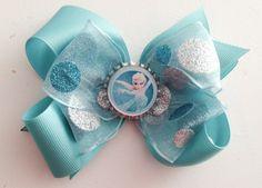 Aqua ribbon with Sparkle Dot Ribbon. Frozen Snow Queen Elsa Bottlecap Hair Bow- $8.00