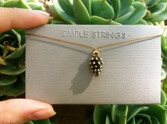 Teeny Tiny Pinecone String Necklace by RoxiSimpleStrings on Etsy, $15.00