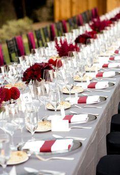 Long table of monochromatic bold red flowers at the Calistoga Ranch. Fleurs de France. www.fleursfrance.com with Suzy Berberian Weddings  Ken Viale Photography  Calistoga Ranch