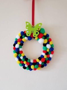 Check out this item in my Etsy shop https://www.etsy.com/uk/listing/609591063/pom-pom-wreath-hanger-rainbow-wreath