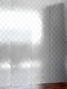 Argyle Silver white (ARG S/W) - Erica Wakerly Wallpapers - A contemporary twist on the classic diamond check design with a very fine vertical white line in the background and a single stripe edge which gives a panel effect. Drawn in white on metallic silver. Please request sample for true colour match. Paste-the-