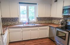 Kitchen with new backsplash and appliances installed