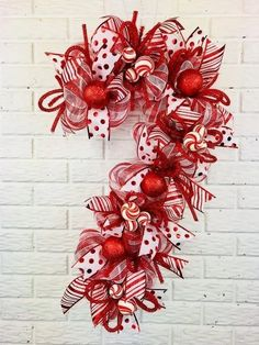 Excited to share this item from my etsy shop candy cane door hanger candy cane wreath candy cane decor large christmas wreath peppermint wreath red and white christmas wreath Large Christmas Wreath, Decoration Christmas, Christmas Gifts For Kids, Holiday Wreaths, Christmas Projects, Christmas Ornaments, Winter Wreaths, Christmas Music, Christmas Movies