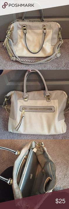 Steve Madden Handbag Neutral/creme colored Steven Madden handbag. Style is a bit oversized and somewhat slouchy. Has zip up sides that can make it more compact. Fits my 13inch MacBook Pro very comfortably. Has shorter handles as well as longer (and removable) straps so can be worn lots of ways, even as a cross body! Carried to work and class for about a month, in great condition, selling only because I no longer need to carry my laptop so don't need as large of a bag anymore! Steve Madden…