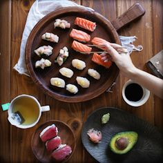 How to make sushi at home, with albacore, ahi, salmon, and scallops.