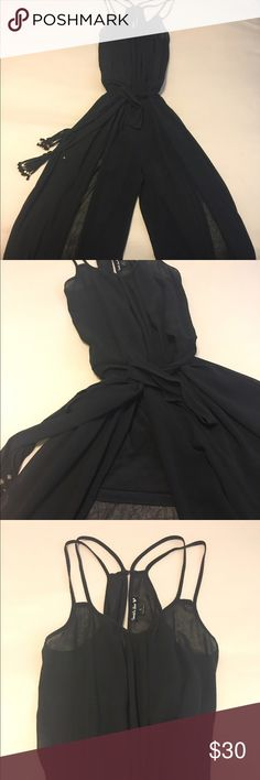 """Black Wide Leg Sheer Jumpsuit Great with a black strapless bra to dress it up or even with a bikini for a pool party. For reference, I am 5'2"""" 32C, 115lb. Double Zero Pants Jumpsuits & Rompers"""