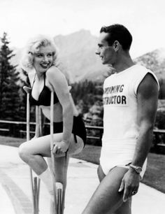 """Marilyn nursing a sprained ankle while on location in Canada during the filming of """"River of No Return"""". Photo by John Vachon, 1953."""