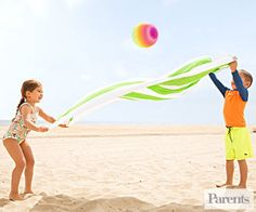 Ask two kids to hold a towel stretched taut and challenge them to bounce a beach ball in the air, catching it with the towel.
