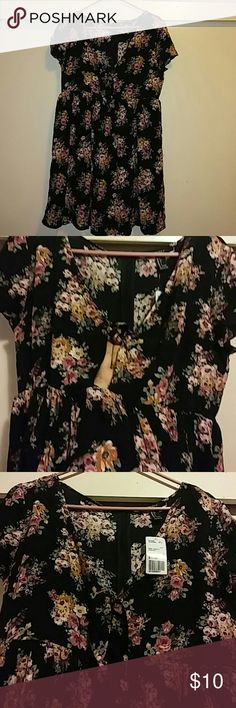 NWT Forever 21 Floral Dress New with tag. Ties at the front with a small keyhole opening. Size: L. Feel free to ask any questions.(: Forever 21 Dresses