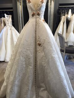 This is how a one-off Steven Khalil Swarovski gown is made: The gown is made of Italian embossed silk jacquard and has an internal netted petticoat. It is a fresh, modern and textural take on the traditional bridal silhouette.