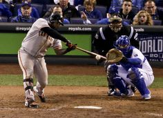 San Francisco Giants' Pablo Sandoval hits a single against the San Francisco Giants during the eighth inning of Game 7 of baseball's World Series Wednesday, Oct. 29, 2014, in Kansas City, Mo. (AP Photo/Charlie Riedel)