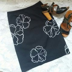 **2for20**Black skirt accented with white flowers Cute skirt, black with white flowers,  built in slip, casual corner Skirts