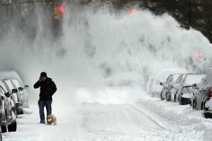 A man and his dog contend with blowing snow in Brooklyn following a snow storm that left up to 8 inches of snow on January 3, 2014 in New York, United States. The major winter snowstorm, which forced New York City public schools to close and shut down the Long Island Expressway, is being viewed as a test for the new mayor of New York City Bill de Blasio. Dangerously cold temperates are predicted for the day and evening hours. (Spencer Platt, Getty Images)