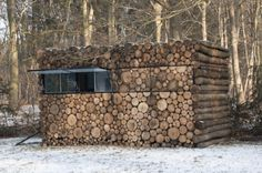 """MUSIC STUDIO disguised as woodpile    Caberetier Hans Liberg wanted a music studio where he can retreat to work on new pieces. Instead of the standard garden shed to build off Liberg designer Piet Hein Eek in to something special. The result is this """"invisible"""" music studio disguised as a woodpile."""