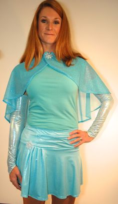 """Depict Elsa with the Character Cape - SnowQueen combined with one of our Frozen-themed skirts.  Flowing aqua cape exemplifies the winter season but lightweight enough for warm running! Includes snowflake pin (best pinned onto shirt to prevent too much movement.) 18"""" length in back. Get the SnowQueen look with one of our SparkleTech skirts and PrincessSleeves!"""