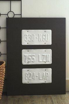 Create unique wall art with license plates. This one of a kind piece becomes fun home decor when you hang it in your home. I absolutely love this DIY idea.