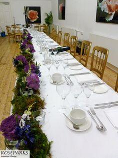 Moss runner on table table in http://www.gatewayrestaurant.net/caledonian.htm