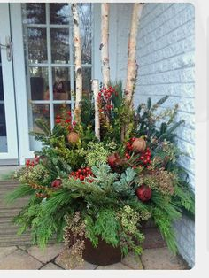 24 Stunning Christmas pots and planters to DIY for almost free! How to create co… 24 Stunning Christmas pots and planters to DIY for almost. Christmas Urns, Outdoor Christmas Decorations, Rustic Christmas, Winter Christmas, Christmas Home, Christmas Wreaths, Thanksgiving Holiday, Winter Porch, Christmas Garden
