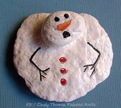 Create a melting snowman with painted rocks.